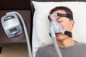 Man sleeping with CPAP