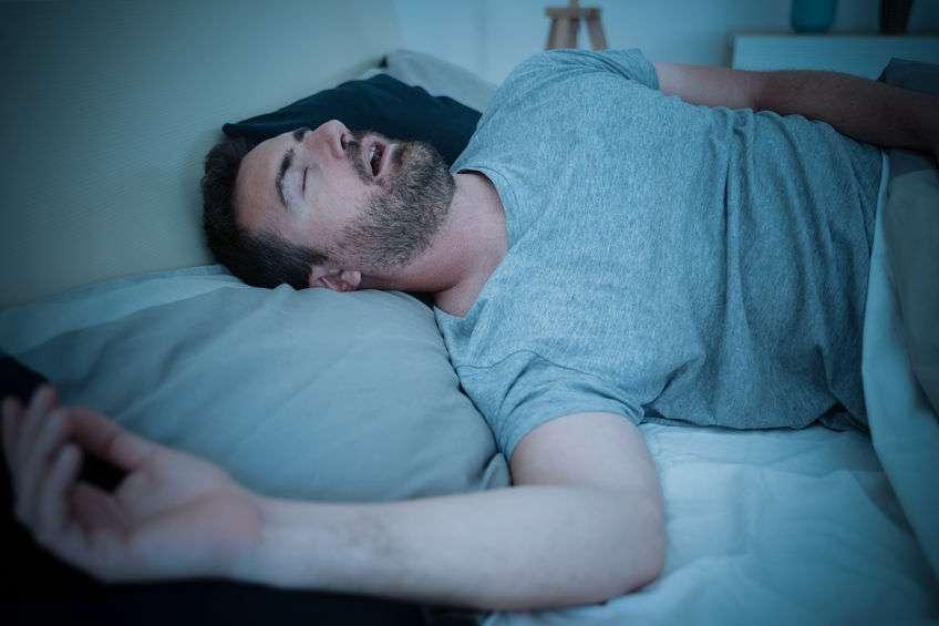 Man Snoring, mouth breathing while sleeping