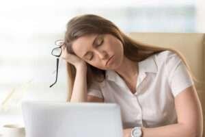 woman at computer falling asleep